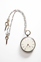 Old-fashioned pocket watch over white background