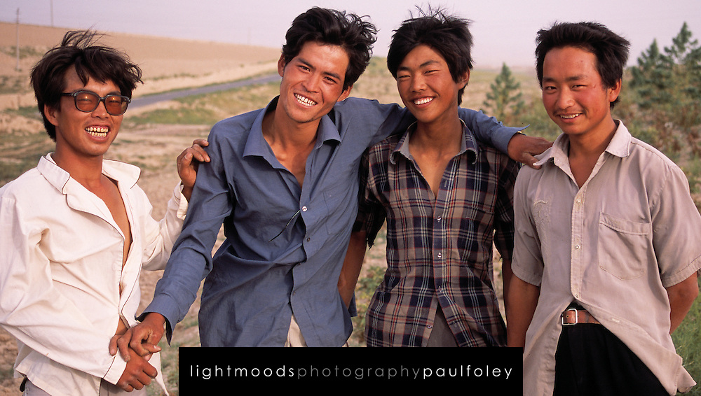 Young men in Wudaolinzi Village near Tongxin. Ningxia Province, China.