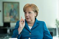 08 MAY 2012, BERLIN/GERMANY:<br /> Angela Merkel, CDU, bundeskanzlerin, waehrend einem Interview in Ihrem Buero, Bundeskanzleramt<br /> IMAGE: 20120508-01-014<br /> KEYWORDS: Büro