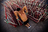 A man exercises using road blocks in downtown Hanoi, Vietnam.