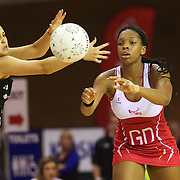 Eboni Beckford-Chambers, England, (right), passes the ball past Paula Griffin, New Zealand, during the New Zealand V England, New World International Netball Series, at the ILT Velodrome, Invercargill, New Zealand. 6th October 2011. Photo Tim Clayton...