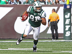 Oct 23, 2011; East Rutherford, NJ, USA; New York Jets tight end Dustin Keller (81) runs with the ball after catching a pass from New York Jets quarterback Mark Sanchez (6) during the first half at MetLife Stadium.