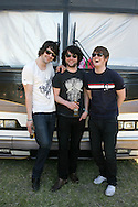 18th April 2009. Indio, California. (L-R) Musicians Liam Fray, Michael Campbell and Daniel Conan Moores, of The Courteeners pose next to their tour bus, at the Coachella Music Festival..PHOTO © JOHN CHAPPLE / REBEL IMAGES.tel +1 310 570 9100    john@chapple.biz