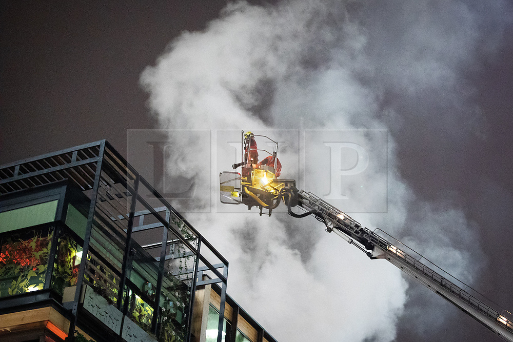 © Licensed to London News Pictures . 04/01/2019 . Manchester , UK . Firefighters attend a fire at the Ivy Restaurant and bar lounge in Spinningfields in Manchester . Photo credit : Joel Goodman/LNP