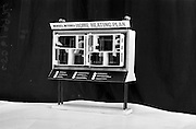 07/05/1965<br /> 05/07/1965<br /> 07 May 1965<br /> Model stand at office of a Home Heating Plan by Monsell Mitchell and Co. Ltd., for McConnells advertising.