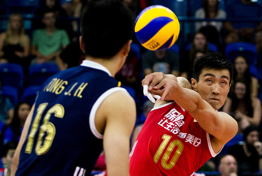 Daoshuai Ji of China attempts to return a serve versus Portugal at a World League Volleyball match at the Sasktel Centre in Saskatoon, Saskatchewan Canada on June 24, 2016.
