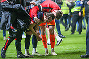 A distraught Doncaster Rovers forward John Marquis (9) is comforted by Doncaster Rovers goalkeeper Ian Lawlor (1) after the EFL Sky Bet League 1 second leg Play-Off match between Charlton Athletic and Doncaster Rovers at The Valley, London, England on 17 May 2019.