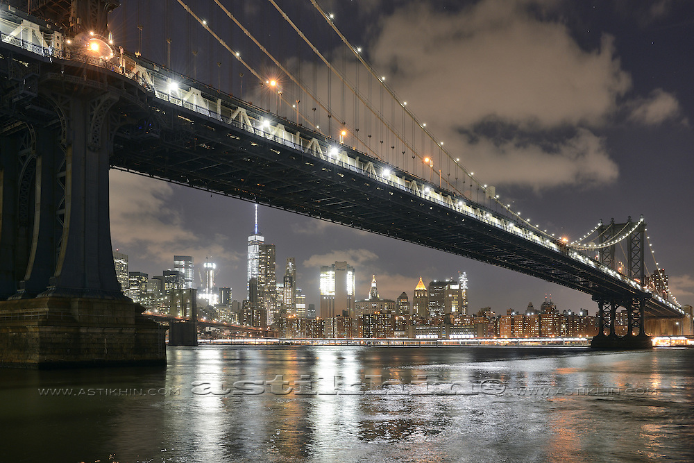 View of the Manhattan under Manhattan Bridge in late evening.