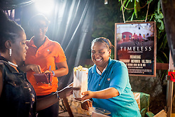 "Keezi Pinney  gives popcorn to movie watchers before the movie.  ""Timeless"" Premier at Reichhold Center for the Arts.  St. Thomas, USVI.  10 October 2015.  © Aisha-Zakiya Boyd"