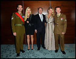 Earl Spencer's daughter Lady Kitty Spencer (2nd Right)the Niece of Princess Diana with to 2 soldiers from 11 EOD regiment after their tour in Afghanistan and Liam Fox, Trustee Belinda McKeeveas (2nd Left) as they attends Give Us Time event in London, United Kingdom. Wednesday, 27th November 2013. Give us Time is a charity set up for service personnel to have holidays with their families after tours in War zones. Picture by Andrew Parsons / i-Images