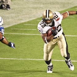 2010 February 07: New Orleans Saints running back Pierre Thomas (23) runs past Indianapolis Colts linebacker Gary Brackett (58) during a 31-17 win by the New Orleans Saints over the Indianapolis Colts in Super Bowl XLIV at Sun Life Stadium in Miami, Florida.