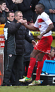 Picture by David Horn/Focus Images Ltd +44 7545 970036.16/03/2013.Lucas Akins of Stevenage celebrates scoring his side's fourth goal with Gary Smith , Manager of Stevenage during the npower League 1 match at the Lamex Stadium, Stevenage.