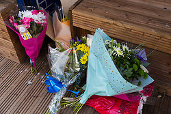 Flowers have been left at the scene on Bickley Road in Leyton where 14-year-old  Jayden Moodie was knocked off his moped and then stabbed to death. Leyton, London, January 09 2019.