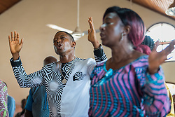 3 November 2019, Monrovia, Liberia: Congregants pray during Sunday service at Saint Andrew Lutheran Parish in Monrovia. Part of the Lutheran Church in Liberia, the parish gathers some 220 members for prayer each week.