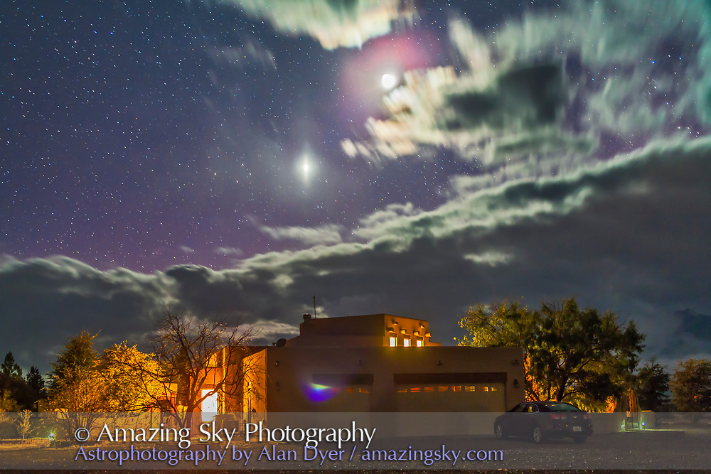 The waxing crescent Moon and Venus (below) over the main adobe house at the Painted Pony Resort, New Mexico, Dec 5, 2013. Clouds were clearing after a day of rain. Taken with the 50mm Sigma lens and Canon 5D MkII, tripod mountedf for 20 seconds at f/2.5 anjd ISO 800.