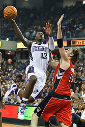 November 1, 2010; Sacramento, CA, USA;  Sacramento Kings point guard Tyreke Evans (13) shoots over Toronto Raptors center David Andersen (13) during the second quarter at ARCO Arena. The Kings defeated the Raptors 111-108.