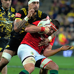 Vaea Fifita tackles CJ Stander during the 2017 DHL Lions Series rugby match between the Hurricanes and British & Irish Lions at Westpac Stadium in Wellington, New Zealand on Tuesday, 27 June 2017. Photo: Dave Lintott / lintottphoto.co.nz