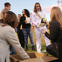 Lauren Wood | Buy at photos.djournal.com<br /> Counselors Brittany Orr, left, and Kelsie Cruse hand a t-shirt to Arden Spearman as she and other students are recognized for scoring a 30 or above on their ACT score before the start of Friday night's game at Pontotoc.