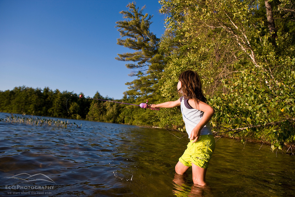 A girl fishing at White Lake State Park in Tamworth, New Hampshire.