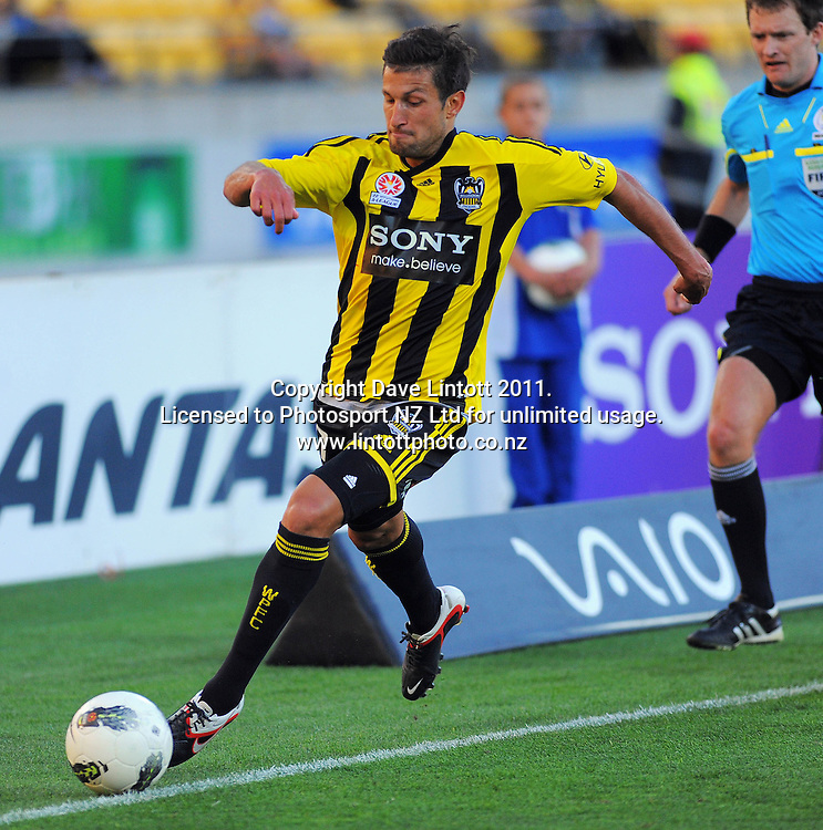 Phoenix' Vinnie Lia takes the ball down the right touchline during the A-League football match between Wellington Phoenix v Newcastle Jets at Westpac Stadium, Wellington, New Zealand on Friday, 23 December 2011. Photo: Dave Lintott / lintottphoto.co.nz