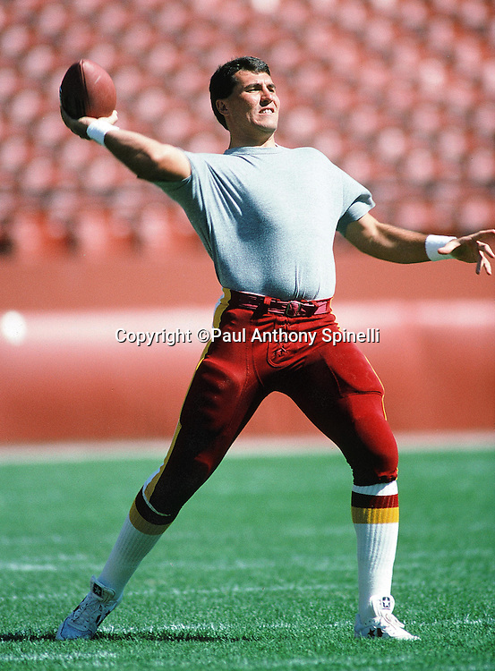 Washington Redskins quarterback Mark Rypien (11) throws a pass before pregame warmups at the NFL football game against the San Francisco 49ers on Sept, 16, 1990 in San Francisco. The 49ers won the game 26-13. (©Paul Anthony Spinelli)
