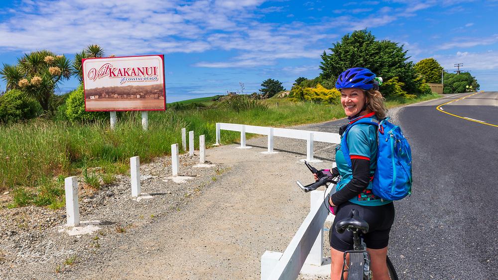 Cyclist on the Otago Coast at Kakanui, Otago, South Island, New Zealand (MR)