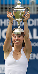 LIVERPOOL, ENGLAND - Saturday, June 18, 2011: Martina Hingis (SUI) with the Boodles Trophy after winning the Women's Final on day three of the Liverpool International Tennis Tournament at Calderstones Park. (Pic by David Rawcliffe/Propaganda)