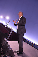 Garden City, New York, USA. June 21, 2018. Former NASA space shuttle astronaut MIKE MASSIMINO, a Long Island native, stands at podium on stage while he gives free lecture in the JetBlue Sky Theater Planetarium at the Cradle of Aviation Museum.