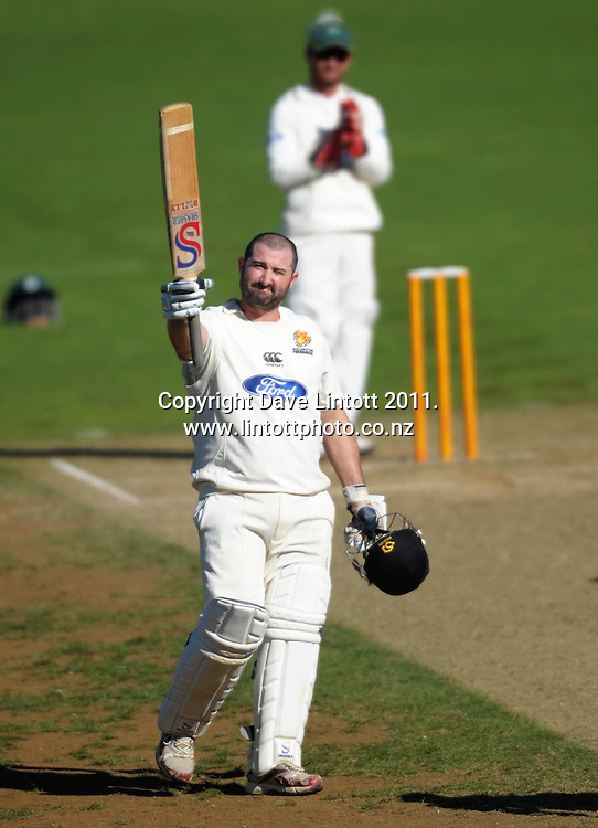 Firebirds batsman Neal Parlane celebrates his century. Plunket Shield cricket - Wellington Firebirds v Central Stags day three at Hawkins Basin Reserve, Wellington, New Zealand on Tuesday, 30 March 2011. Photo: Dave Lintott / lintottphoto.co.nz