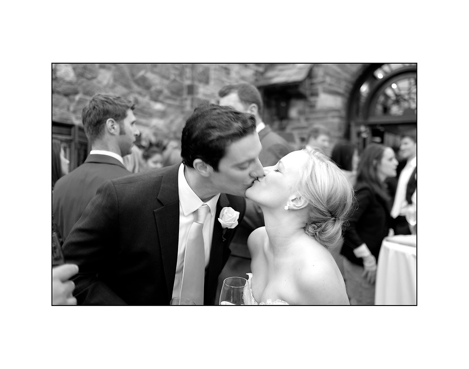 Steve Thompson and Kim Seedor kiss on their wedding day t the Wingedfoot Golf Club in Mamaroneck NY
