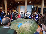 Bellaire and Pin Oak students at the Grand Tetons National Park Visitor Center listen to a park ranger who is giving them background on the park.