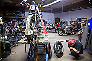 May 10, 2013 – New York, NY. Christopher Hanes works on a bike inside of Williamsburg's MotorGrrl. MotorGrrl serves as a storage garage and a repair shop for motorcycle riders in the area. 05/10/2013 Photograph by Jeanette D. Moses/NYCity Photo Wire