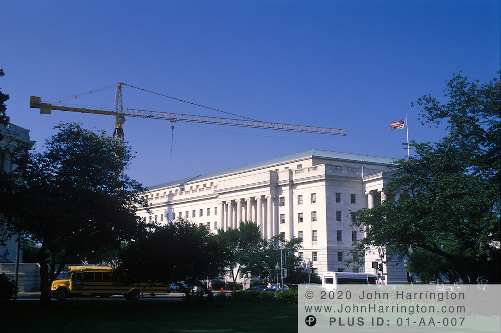 Offices of the US Congress and construction cranes.