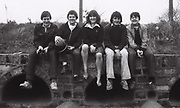 Five friends sit above sewage outlet pipes of ealing sports ground. London, Greenford, UK, 1980s.