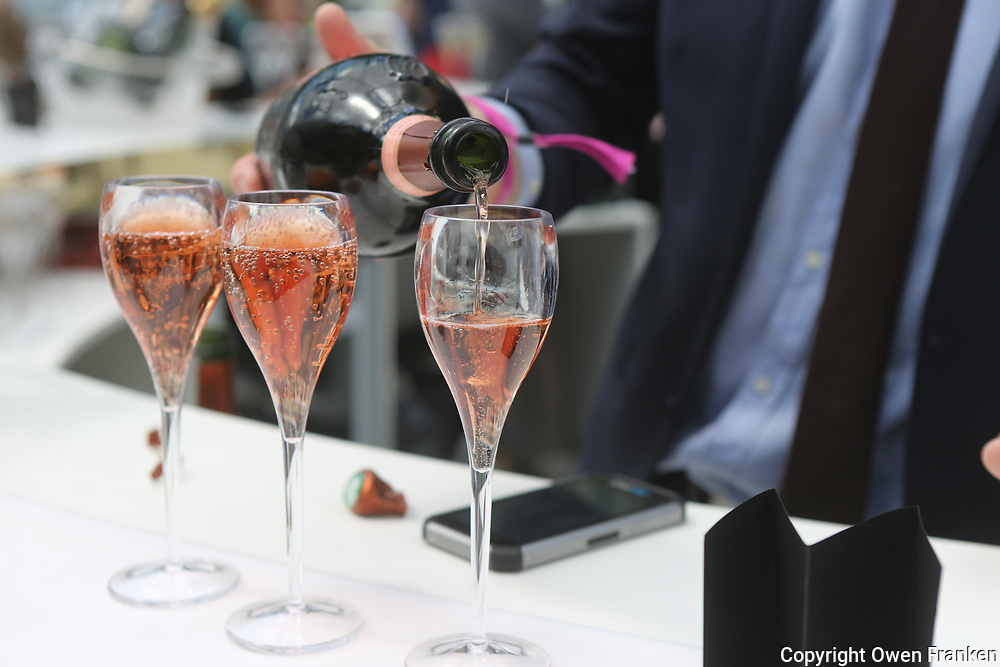 pouring rosé Champagne at the food fair, Taste of Paris