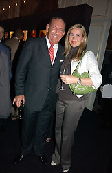 BRIAN CRAWFORD and TV presenter SARAH HEANEY at a party hosted by Ruinart Champagne at Claridges, Brook Street, London on 18th October 2006.<br />