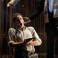American Lulu<br /> Edinburgh International Festival<br /> Scottish Opera and The Opera Group<br /> Picture shows :  Paul Curievici as the painter (l)  and Donald Maxwell as Dr Bloom (r).<br /> Picture &copy;&nbsp;Drew Farrell<br /> Tel : 07721-735041<br /> Please note image offered on a 'Speculative Basis'.<br /> <br /> Dates:   Fri 30 &amp; Sat 31 August 2013<br /> Venue:  King's Theatre<br /> <br /> Seductress, victim, manipulator: Lulu lives off men as both tortured and torturer, purveyor of ecstasy and angel of death.<br /> Caught up in greedy games and seedy schemes, and surrounded by lovers driven to despair, Lulu makes an inexorable rise to the highest levels of power, money and fame. But her descent is just as swift. Twenty years on, as the scarred Lulu looks back on her life, she faces a squalid history of sex, murder and violence.<br /> Award-winning Austrian composer Olga Neuwirth has radically reworked Alban Berg&rsquo;s unfinished 1934 opera for the 21st century, setting it against the backdrop of the US civil rights struggles of the 1950s and 1960s and transporting audiences to the smoky jazz clubs of the Deep South. Neuwirth re-interprets Berg&rsquo;s score for a jazz-inspired &lsquo;Las– Vegas&rsquo;-style ensemble while also integrating her own distinctive voice to make a sound world that casts new light on the whole opera.<br /> <br /> This new production is conducted by leading contemporary music specialist Gerry Cornelius and staged by the acclaimed British director John Fulljames, with The Orchestra of Scottish Opera.<br /> <br /> A co-production with The Opera Group, Scottish Opera, Bregenzer Festspiele and Young Vic in association with the London Sinfonietta.<br /> Overal concept and interpretation of&nbsp;Alban Berg's&nbsp;opera&nbsp;Lulu&nbsp;by Olga Neuwirth<br /> Scottish Opera&nbsp;and&nbsp;The Opera Group<br /> Conductor Gerry Cornelius<br /> Director John Fulljames<br /> Designer Magda Willi<br /> Video designer&nbsp;Finn Ross<br /> Lighting designer Guy Hoare<br /> <br /> CAST<br /> Lulu&nbsp;Angel Blue<br /> Eleanor&nbsp;Jacqui Dankworth<br /> Dr Bloom&nbsp;Donald Maxwell<br /> Clarence&nbsp;Robert Winslade Anderson<br /> Jimmy&nbsp;Jonathan Stoughton<br /> Painter&nbsp;Paul Curievici<br /> Athlete&nbsp;Simon