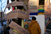 Signs at the Occupy Amsterdam demonstration outside the Amsterdam Stock Exchange at Beursplein, Amsterdam, the Netherlands. This is one of many 'occupy' protests fallowing the Occupy Wall Street protests in New York, against economic inequality. October 19th 2011.