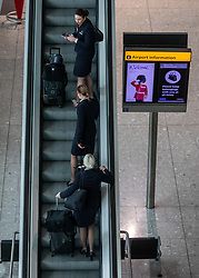 © Licensed to London News Pictures. 10/03/2020. London, UK. Flight attendants arrive at a quiet Terminal 5 as British Airways cancels all flights to and from Italy over fears of the Coronavirus disease. Photo credit: Alex Lentati/LNP