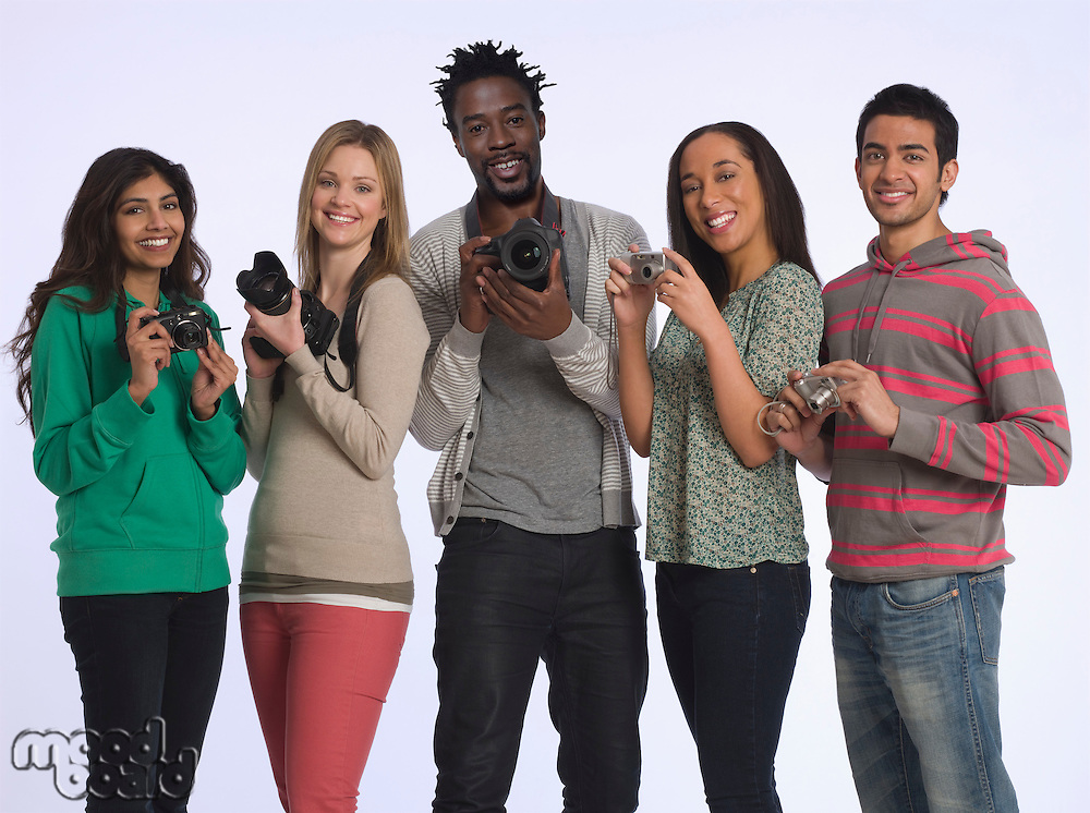 Group of young people holding cameras studio shot