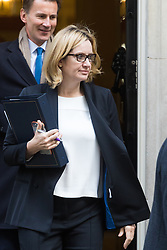 Downing Street, London, October 18th 2016. Home Secretary Amber Rudd, followed by Health Secretary Jeremy Hunt, leaves 10 Downing Street in London following the weekly cabinet meeting.