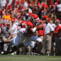 Apr 18, 2009; Piscataway, NJ, USA; Rutgers WR Tim Brown (2) grabs a pass and is dragged down by DB David Rowe (4) during the first half of Rutgers' Scarlet and White spring football scrimmage.