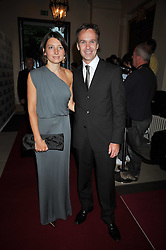 Chef MARCUS WAREING and his wife JANE at the annual GQ Awards held at the Royal Opera House, Covent Garden, London on 8th September 2009.