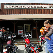 Ian and Nicole Cattabriga, of Wilder, right, share a lengthy kiss in Cornish Saturday before hopping back on their motorcycles to continue a recreational ride with friends.