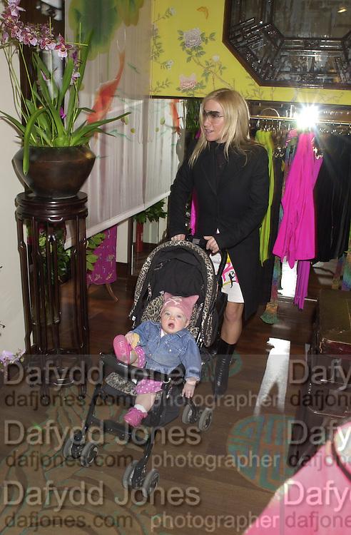Meg Matthews and Anias. Shanghai Tang opening. Sloane St. 11 April 2001. © Copyright Photograph by Dafydd Jones 66 Stockwell Park Rd. London SW9 0DA Tel 020 7733 0108 www.dafjones.com