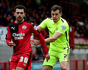 Crawley Town Midfielder Lyle Della (30) in action against Hartlepool United defender Carl Magnay (2) during the Sky Bet League 2 match between Crawley Town and Hartlepool United at the Checkatrade.com Stadium, Crawley, England on 19 March 2016. Photo by Jon Bromley.