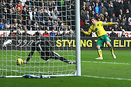 Picture by Paul Chesterton/Focus Images Ltd.  07904 640267.11/02/12.Grant Holt of Norwich scores his sides 3rd goal and celebrates during the Barclays Premier League match at Liberty Stadium, Swansea.