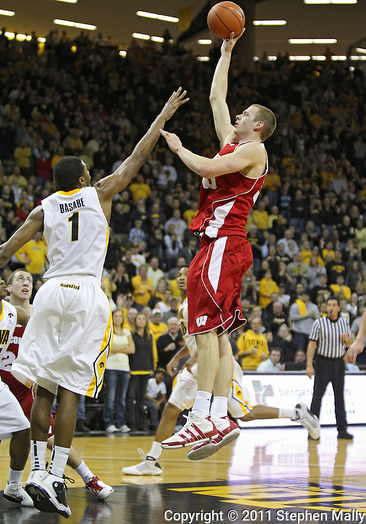 February 09 2011: Wisconsin Badgers forward Jon Leuer (30) puts up a shot over Iowa Hawkeyes forward Melsahn Basabe (1) during the first half of an NCAA college basketball game at Carver-Hawkeye Arena in Iowa City, Iowa on February 9, 2011. Wisconsin defeated Iowa 62-59.
