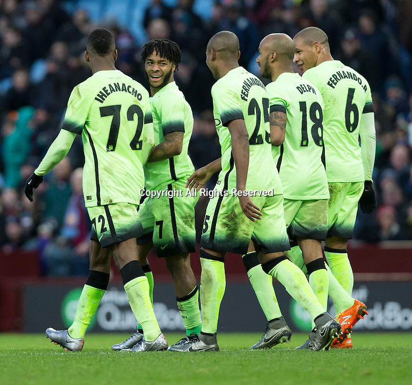 30.01.2016. Villa Park, Birmingham, England. Emirates FA Cup 4th Round. Aston Villa versus Manchester City. Manchester City midfielder Raheem Sterling celebrates with his team mates after scoring his teams fourth goal in the 76th minute (0-4).