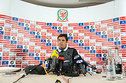 CARDIFF, WALES - Monday, March 25, 2013: Wales' manager Chris Coleman during a press conference at the St. David's Hotel ahead of the 2014 FIFA World Cup Brazil Qualifying Group A match against Croatia. (Pic by David Rawcliffe/Propaganda)